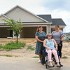 LEANDRA BEABOUT | THE GOSHEN NEWS<br /> From left: Marcia, Abby and Ellie Hershberger stand in front of their future home in Goshen.