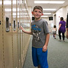 "LEANDRA BEABOUT | THE GOSHEN NEWS<br /> Ryder Eppert, 6, finds his first grade locker at Syracuse Elementary School on ""Back to School"" night Tuesday."