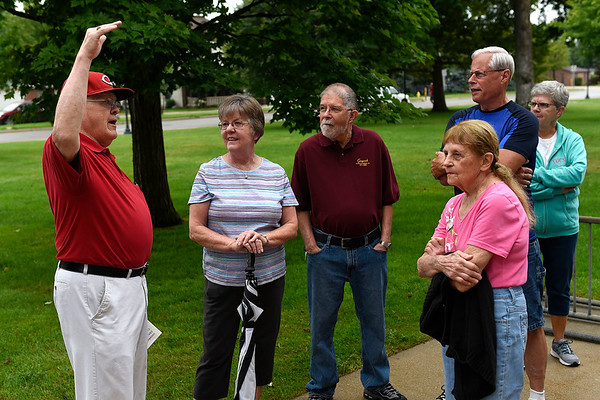 BEN MIKESELL | THE GOSHEN NEWS<br /> Ron Hoke with the Goshen Historical Society, left, prepares a group of more than a dozen people to enter the Elkhart County Courthouse for a tour Thursday morning in Goshen.
