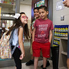 LEANDRA BEABOUT | THE GOSHEN NEWS<br /> Kindergartener Valerie Del Rio, 5, shows off her sparkly new backback to her teacher. Her brothers Adrian Del Rio, 8, and Luis Del Rio, 12, stand nearby.
