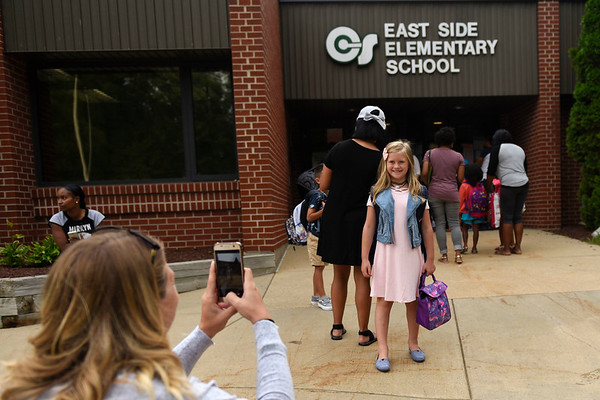 BEN MIKESELL | THE GOSHEN NEWS<br /> Second-grade student Emma Getz has her photo taken for the first day of school by her mother Valerie Ronzone Wednesday morning at Concord East Side Elementary School.