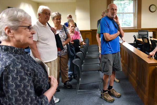 BEN MIKESELL | THE GOSHEN NEWS<br /> People listen to bailiff Geri Krueger during a tour of the Elkhart County Courthouse Thursday morning in Goshen.