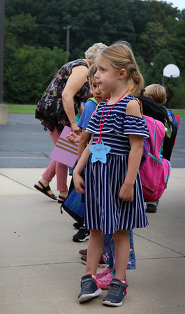 JULIE CROTHERS BEER   THE GOSHEN NEWS<br /> Kindergartner Sophia Griffith serves as line leader for Melanie William's class on the first day of school Wednesday at Woodview Elementary School in Nappanee.