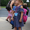JULIE CROTHERS BEER | THE GOSHEN NEWS<br /> Kindergartner Sophia Griffith serves as line leader for Melanie William's class on the first day of school Wednesday at Woodview Elementary School in Nappanee.