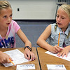 JULIE CROTHERS BEER | THE GOSHEN NEWS<br /> Classmates Addison Davis and Allie Yoder work on a worksheet Wednesday during their first day of fourth grade at Woodview Elementary School in Nappanee.
