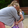 BEN MIKESELL | THE GOSHEN NEWS<br /> Second-grade student Emma Getz hugs her mother Valerie Ronzone Wednesday morning at Concord East Side Elementary School.