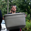 GEOFF LESAR | THE GOSHEN NEWS<br /> <br /> Brandon Roe, a broadcasting major from Lancaster, Penn., hauls a tub Saturday morning during move-in day at Goshen College. Session I classes begin today.