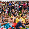 BEN MIKESELL | THE GOSHEN NEWS<br /> Hundreds of people gather to watch the heats during United Way's Great Cardboard Boat Race Friday afternoon in Elkhart.
