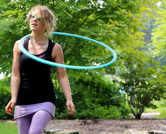 GEOFF LESAR | THE GOSHEN NEWS<br /> <br /> Meghan Provost, of South Bend, hoops Sunday afternoon during the 10th annual Taste of the Gardens at Wellfield Botanic Gardens in Elkhart.