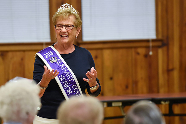 BEN MIKESELL | THE GOSHEN NEWS<br /> 2018 Elkhart County 4-H senior queen Marceil Yoder speaks to the crowd gathered Tuesday morning to celebrate National Senior Citizen Day at McNaughton Park in Elkhart.