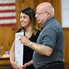 BEN MIKESELL | THE GOSHEN NEWS<br /> Council on Aging CEO David Toney, right, congratulates Ashley Jordan, of Elkhart, for winning the first-ever Senior Advocacy Award for her contributions with Acts of Service Tuesday morning at McNaughton Park in Elkhart.