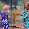 GEOFF LESAR | THE GOSHEN NEWS<br /> <br /> Eleanor Roberts, 4, of Granger, waters the children's garden Sunday afternoon during the 10th annual Taste of the Gardens at Wellfield Botanic Gardens in Elkhart.