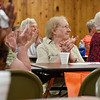BEN MIKESELL | THE GOSHEN NEWS<br /> People attending the National Senior Citizen Day celebration applaud while watching the day's entertainment Tuesday morning at McNaughton Park in Elkhart.