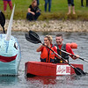 BEN MIKESELL | THE GOSHEN NEWS<br /> Bree Underhill, front, and Brian Shelton, back, both of Granger, compete for first place during United Way's Great Cardboard Boat Race Friday afternoon in Elkhart.