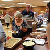 BEN MIKESELL | THE GOSHEN NEWS<br /> Attendees celebrating National Senior Citizen Day get their free meals, provided by various health care sponsors Tuesday morning at McNaughton Park in Elkhart.