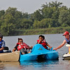 GEOFF LESAR | THE GOSHEN NEWS<br /> <br /> Elkhart's Jon Miller, right, of the Goshen Parks and Recreation Department, guides a group of people, who wished to remain anonymous, back to the shores of Fidler Pond Sunday evening. The group of four was on the water with a second canoe carrying others when that canoe capsized. Miller rescued those in the water prior to safely escorting the second group.