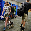 BEN MIKESELL | THE GOSHEN NEWS<br /> Freshman Evelyn Lapadat walks her service dog, a miniature Australian Shepherd named Zeus, down the halls during the first day of school Tuesday morning at Bethany Christian Schools.