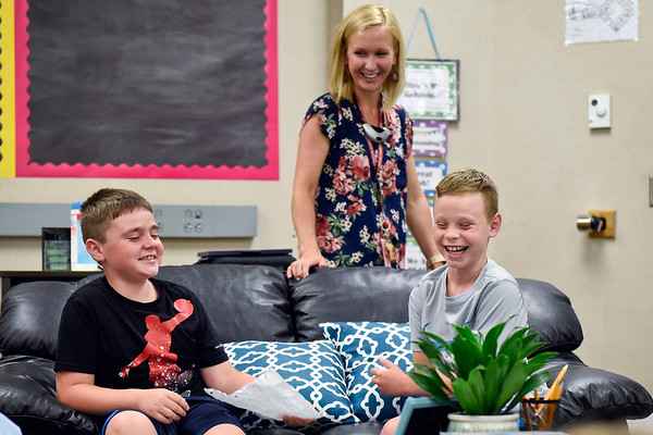 BEN MIKESELL   THE GOSHEN NEWS<br /> Fourth graders Adam Schulz, left, and Zach Pierce, right, laugh while playing an icebreaker game for the first day of school in Rebecca Courtney's class Thursday afternoon at Jimtown Intermediate School.