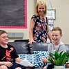 BEN MIKESELL | THE GOSHEN NEWS<br /> Fourth graders Adam Schulz, left, and Zach Pierce, right, laugh while playing an icebreaker game for the first day of school in Rebecca Courtney's class Thursday afternoon at Jimtown Intermediate School.