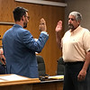 JOHN KLINE | THE GOSHEN NEWS<br /> Goshen Mayor Jeremy Stutsman, left, delivers the oath of office to Stephen M. Priem following his promotion from the rank of patrol officer to the rank of detective with the Goshen Police Department during Monday's Board of Public Works and Safety meeting.