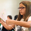 BEN MIKESELL | THE GOSHEN NEWS<br /> Third-grade student Trinity Avila cuts out a drawing in Carley Matthes' class during the first day back to school Monday afternoon at Clinton Christian School in Goshen.