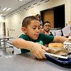 LEANDRA BEABOUT | THE GOSHEN NEWS<br /> Kindergartener Isaac Segobia, 5, concentrates as he tries to balance his lunch tray before heading to his seat on the first day of school at West Noble Primary School.