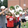 BEN MIKESELL | THE GOSHEN NEWS<br /> Goshen High School junior Ainsley Friesen plays the mellophone during practice Friday afternoon.