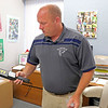 "GEOFF LESAR | THE GOSHEN NEWS<br /> <br /> Fairfield Jr.-Sr. High School Assistant Principal Nick Jones displays one of the new metal-detecting wands recently acquired by the school. Until an official policy can be adopted, Jones said the wands will be used on an as-needed basis when there is ""reasonable suspicion"" to be believe a student may be in possession of a metallic weapon."