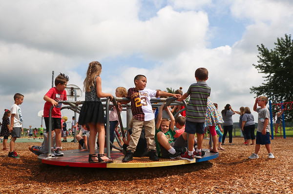 LEANDRA BEABOUT | THE GOSHEN NEWS<br /> Second grade students at Benton Elementary School enjoy recess on the first day of the school year.