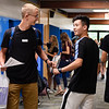 BEN MIKESELL | THE GOSHEN NEWS<br /> Juniors Caleb Shank, left, and Xudong Sun, right, greet each other in passing during the first day of school Tuesday morning at Bethany Christian Schools.