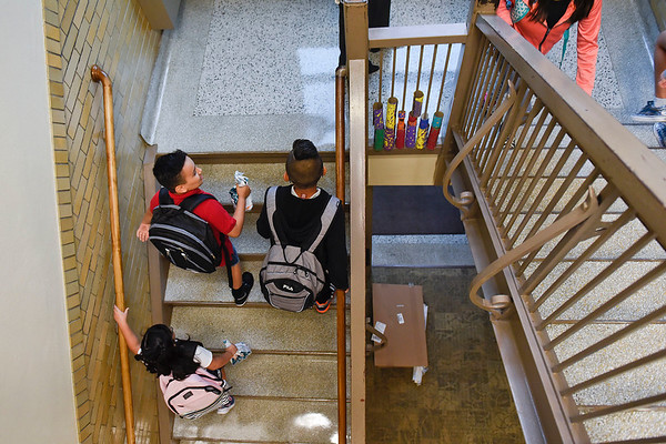 BEN MIKESELL | THE GOSHEN NEWS<br /> Students make their way up the stairs for the first day of school Wednesday morning at Chamberlain Elementary School.