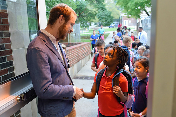 BEN MIKESELL | THE GOSHEN NEWS<br /> Teacher Daniel Gingerich greets first grade student Andi Snyder as he walks in for his first day of school Wednesday morning at Chamberlain Elementary School.