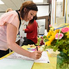 BEN MIKESELL | THE GOSHEN NEWS<br /> Clerk Rachel Spencer signs a poster for circuit court clerk Wendy Hudson during her going away party Thursday morning at the Elkhart County Courthouse.