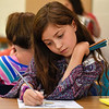 BEN MIKESELL | THE GOSHEN NEWS<br /> Third-grade student Elyse Clark draws in Carley Matthes' class during the first day back to school Monday afternoon at Clinton Christian School in Goshen.