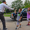 BEN MIKESELL | THE GOSHEN NEWS<br /> Ray Caldwell, teacher on special assignment, greets students for the first day of school Wednesday morning at Chamberlain Elementary School.