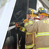 AIMEE AMBROSE | THE GOSHEN NEWS<br /> <br /> Nappanee firefighters extinguish a hot spot at the scene of a fire that destroyed the Marway Welding shop, 27097 C.R. 50, Monday morning.