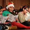 "BEN MIKESELL | THE GOSHEN NEWS<br /> Students from Chamberlain Elementary School sing ""Jingle Bells"" to the crowd gathered Friday for First Friday festivities at the Goshen Theater. The students, ranging from third- to fifth-graders, had been practicing Christmas carols since the beginning of November, music teacher Jenni Sears said."