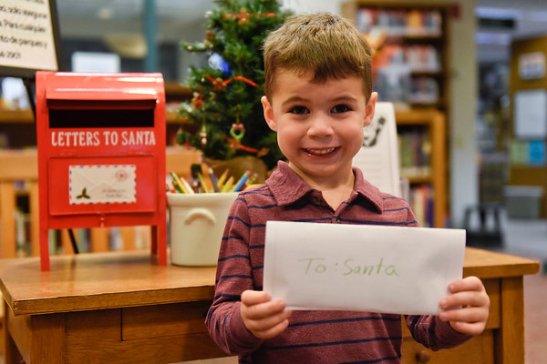 BEN MIKESELL | THE GOSHEN NEWS<br /> Myles Yoder, 4, Syracuse, prepares to drop his letter to Santa in the mailbox at the Goshen Public Library. Yoder attends New Paris Elementary preschool. His parents are Lance and Wendy.