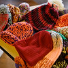 BEN MIKESELL | THE GOSHEN NEWS<br /> Knit caps are layed out on a table waiting to be sorted by Goshen High School students at the Goshen Community Schools Administration Building.