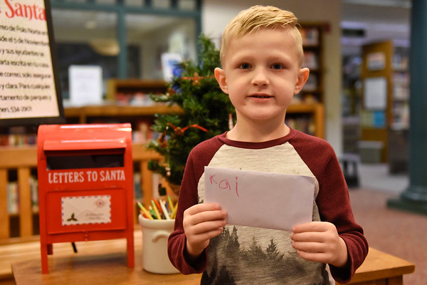 BEN MIKESELL | THE GOSHEN NEWS<br /> Kai Morningstar, 5, Goshen, prepares to drop his letter to Santa in the mailbox at the Goshen Public Library. Morningstar attends Good Shepherd Preschool. His parents are Adam and Tiffany.