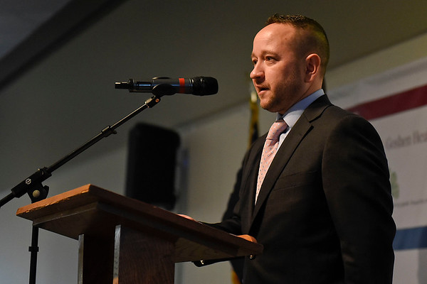BEN MIKESELL | THE GOSHEN NEWS<br /> Lyle Miller, owner of Dutch Maid Bakery, speaks after winning the Maple Leaf Award for Small Business during the annual Chamber of Commerce luncheon Thursday at Maple City Chapel.