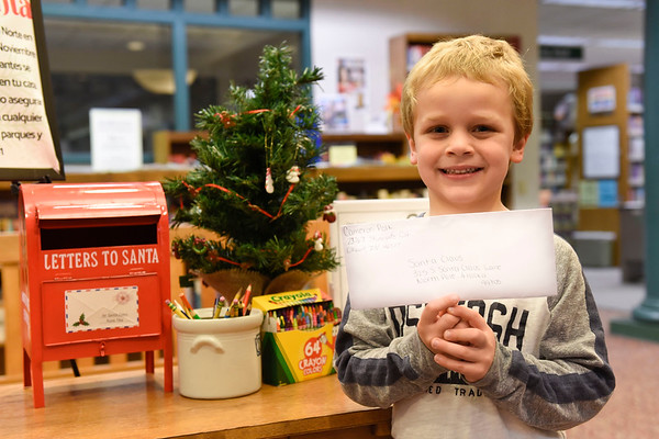 BEN MIKESELL | THE GOSHEN NEWS<br /> Cameron Polk, 4, Elkhart, prepares to drop his letter to Santa in the mailbox at the Goshen Public Library. Polk attends Growing Kids Learning Center. His parents are Brooke and Ben.