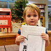 BEN MIKESELL | THE GOSHEN NEWS<br /> Avery Plank, 3, Goshen, prepares to drop his letter to Santa in the mailbox at the Goshen Public Library. Plank attends Walnut Hill Early Childhood. His parents are Amber and Luke.