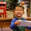 BEN MIKESELL | THE GOSHEN NEWS<br /> Max Yoder, 2, Syracuse, prepares to drop his letter to Santa in the mailbox at the Goshen Public Library. His parents are Lance and Wendy.