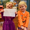 BEN MIKESELL | THE GOSHEN NEWS<br /> Kate Mierau, 5, left, and her sister Molly, both of Goshen, prepare to drop their letters to Santa into the mailbox at the Goshen Public Library. Kate and Molly attend Good Shepherd Preschool. Their parents are David and Kim.