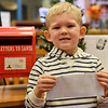 BEN MIKESELL | THE GOSHEN NEWS<br /> Carter Martin, 4, Goshen, prepares to drop his letter to Santa in the mailbox at the Goshen Public Library. Martin attends Eighth Street Preschool. His parents are Chris and Gretchen.