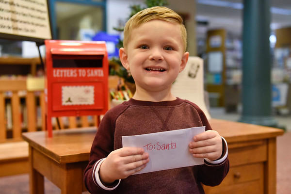 BEN MIKESELL | THE GOSHEN NEWS<br /> Maven Morningstar, 3, Goshen, prepares to drop his letter to Santa in the mailbox at the Goshen Public Library. His parents are Adam and Tiffany.