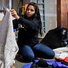 BEN MIKESELL | THE GOSHEN NEWS<br /> Goshen High School senior Monse Hernandez sorts coats for the annual United Way coat drive Wednesday afternoon at the Goshen Community Schools Administration Building.