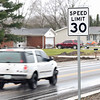 BEN MIKESELL | THE GOSHEN NEWS<br /> Vehicles drive down Kercher Road after the road reopened Monday morning. The speed limit has been temporarily lowered to 30 mph for the winter until the construction can be completed in the spring of 2019.
