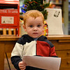 BEN MIKESELL | THE GOSHEN NEWS<br /> Finn Kupke, 2, Goshen, prepares to drop his letter to Santa into the mailbox at the Goshen Public Library. His parents are Jack and Sara.